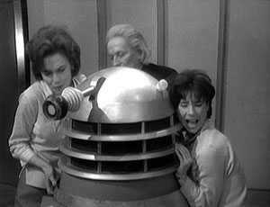 Barbara, the Doctor and Susan attempt to extricate Ian from inside the Dalek.