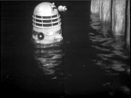 A submerged Dalek emerging from the Thames River