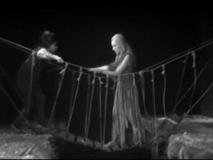 Sabetha, with the assistance of Susan, crosses that ravine.