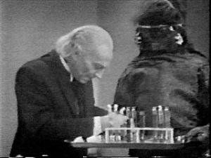 A very obliging Mark 1 Monoid assists the Doctor as he attempts to find a cure for the common cold