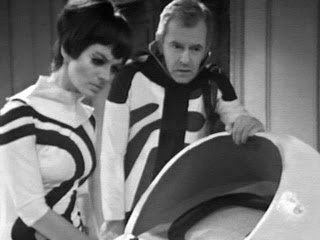 Clent and Miss Gifford with the futurist great World Computer. The Brittanicus Base crew had the most fabulous close fitting outfits