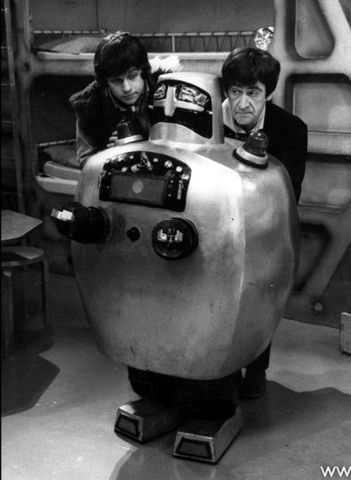 Jamie and the Doctor with the Servo-Robot which subsequently rendered the Doctor unconscious
