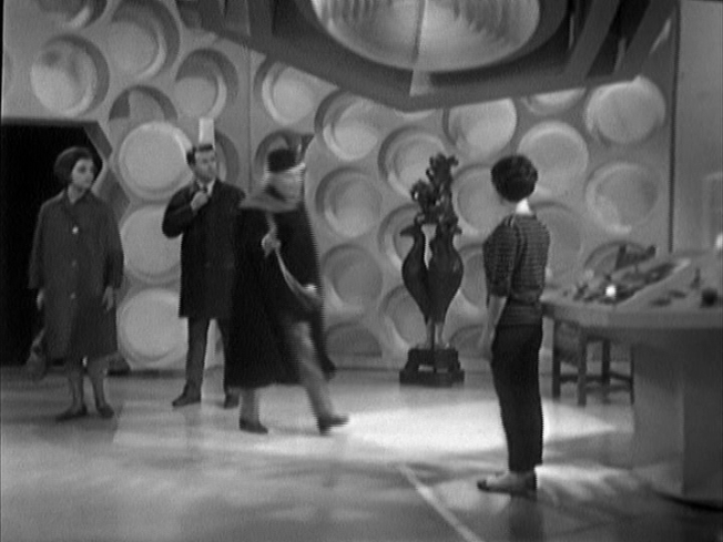 The Doctor's cape is seen more clearly here in the first episode of An Unearthly Child.  This scene has been recreated for An Adventure in Space and Time