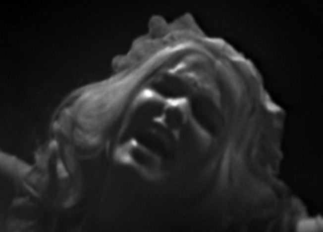 The Grey Woman screams