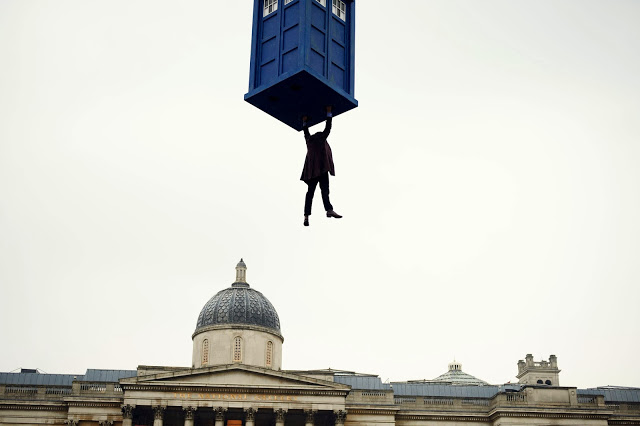 The Eleventh Doctor hangs from the TARDIS above Trafalgar Square