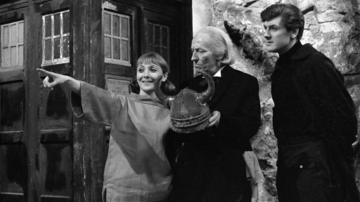 The TARDIS Crew land on a beach with a steep cliff face