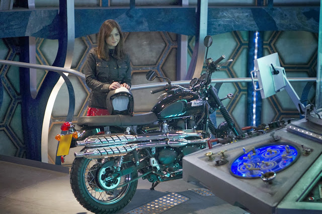 Clara rides a motorbike into the TARDIS