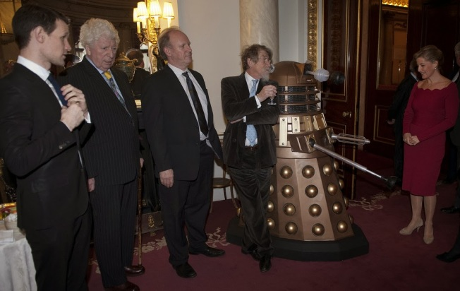 John Hurt leans nonchalantly against a Dalek.  What a classic image!