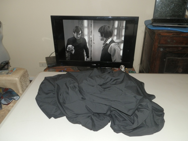 10 metres or more of broadcloth awaits ironing and torture by dressmaking pins.  The Doctor and Jamie appear disinterested