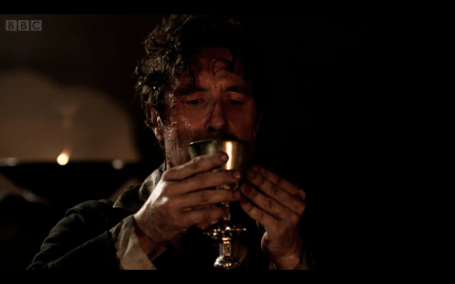 Having chosen his fate, the Eighth Doctor drinks the potion provided to him by the Sisters of Karn